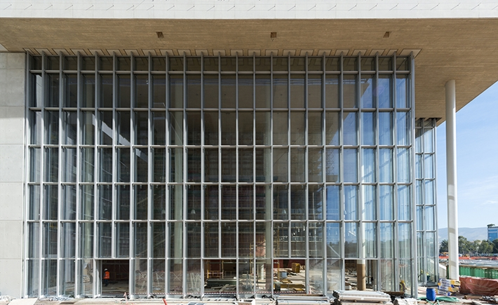 At the Agora. Τhe glass facade of the NLG building / Source: Yiorgis Yerolymbos